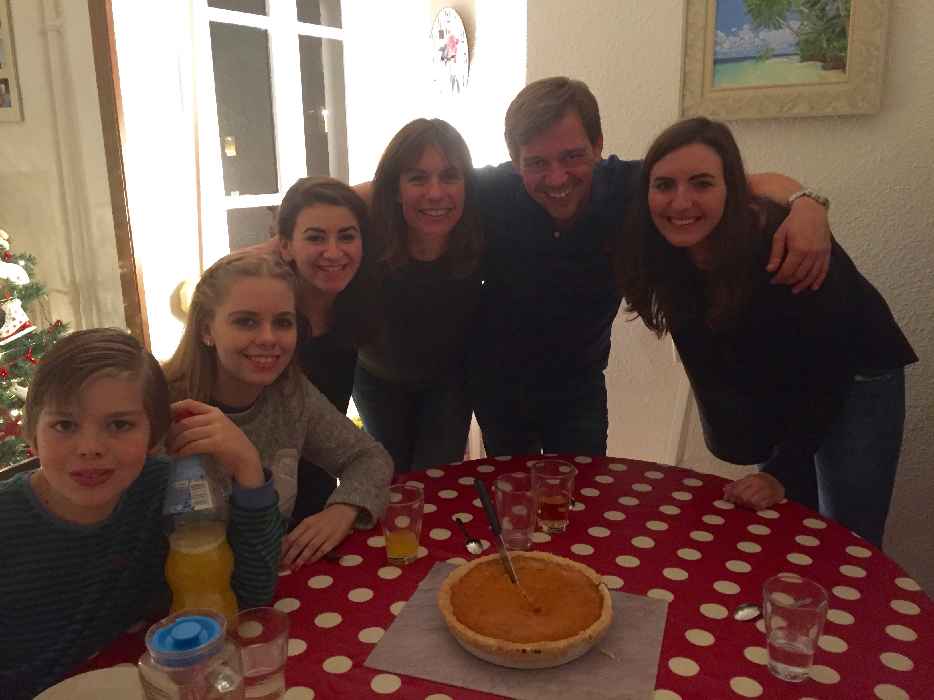 Katherine with her host family and roommate, on their last night in Madrid when they baked a traditional, American pumpkin pie for dessert.