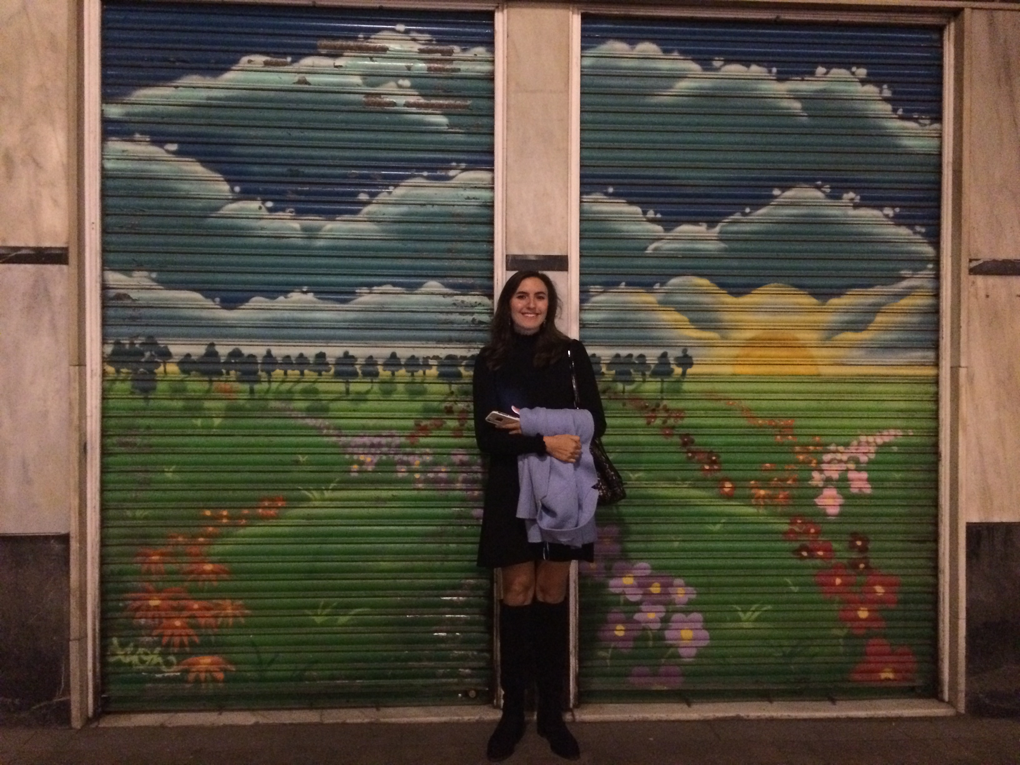 Katherine, in front of one of Madrid's many murals, on one of her favorite streets: Calle de las Huertas.