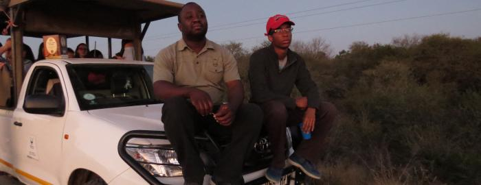 Photo of Niisoja Torto in South Africa on hood of vehicle