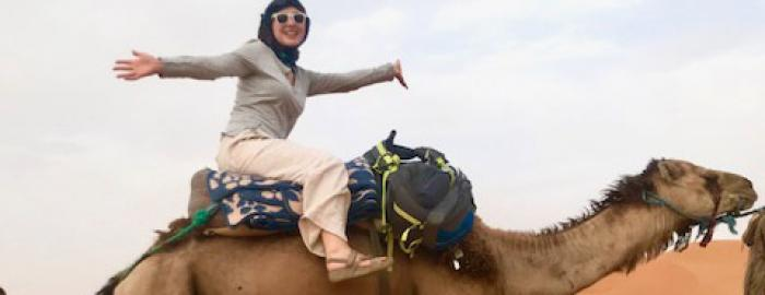 Bailey Carkenord on a camel