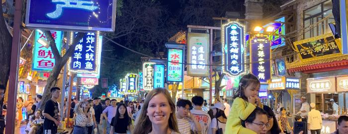 Sanna standing on a street in China